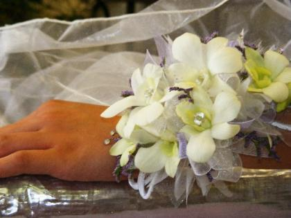 Add a beautiful corsage to your attire for prom or homecoming!